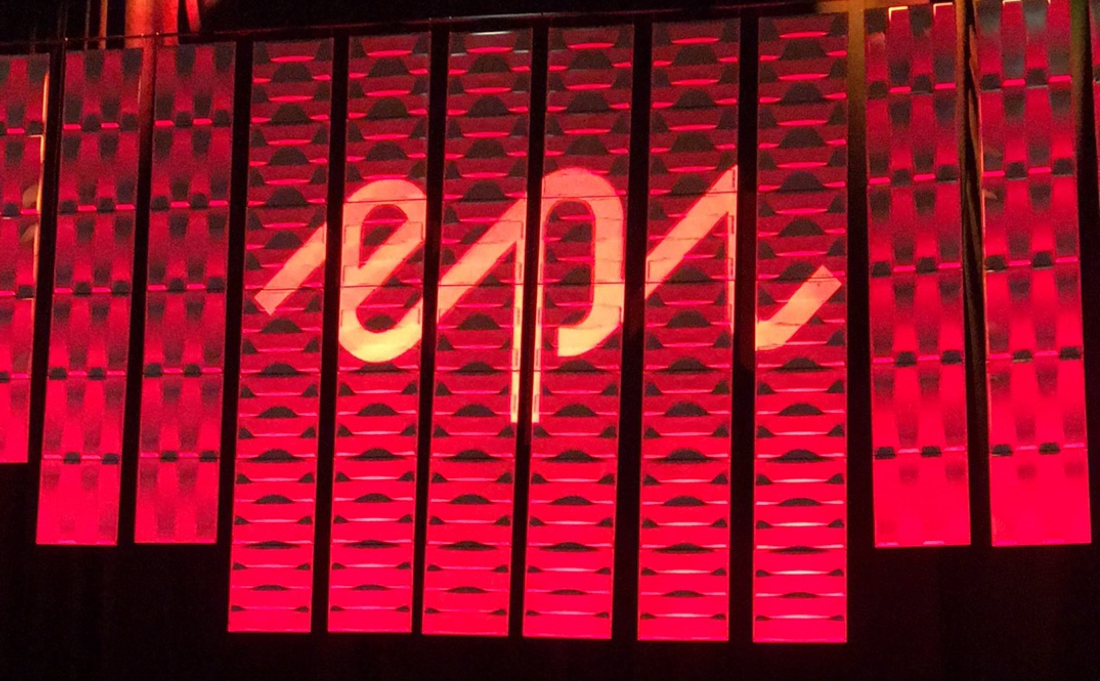 Stage at Episerver Ascend Conference.  Red curtain with Epi logo.