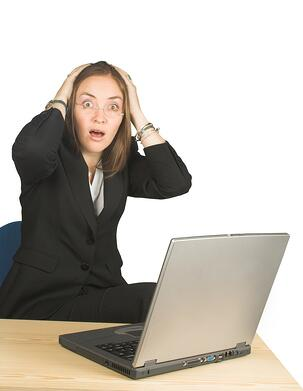 shocked business woman whilst working on her pc.jpeg